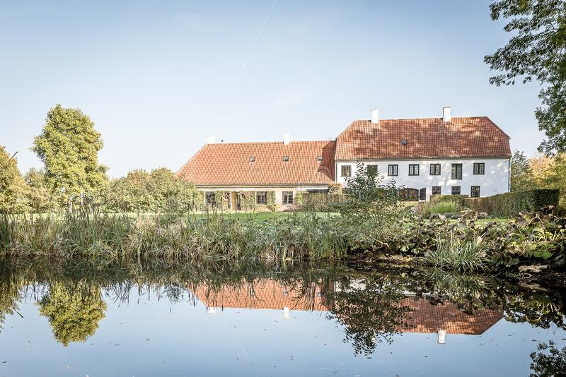Rungstedlund, the home of the danish writer Karen Blixen. Rungstedlund, the home of the danish writer and storyteller Karen Blixen, reflections in the pund stock photography
