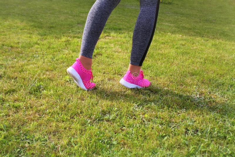 Runner athlete preparing to run the outdoor. Fitness woman training and jogging in summer park royalty free stock image