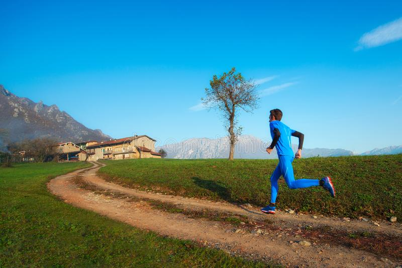Runner athlete professional training on a mountain dirt stock images