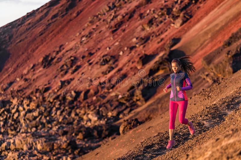 Runner athlete running on mountain trail. Young woman ultra run athlete running fitness workout. Healthy and active lifestyle,. Strong person jogging outdoor royalty free stock photo