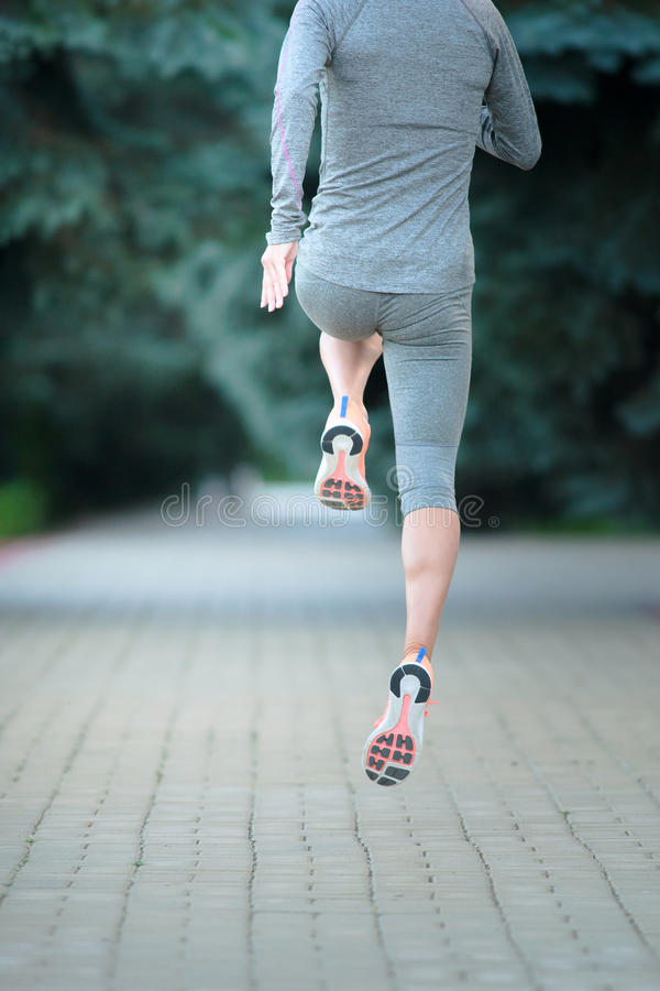 Runner athlete running on road. Woman fitness jogging workout we royalty free stock photo