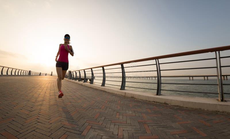 Runner athlete running at seaside royalty free stock photo