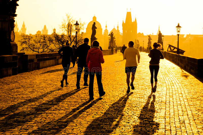 Runner athletes have morning jogging workout on Charles Bridge in Prague, Czech Republic. Healthy lifestyle and active royalty free stock photography