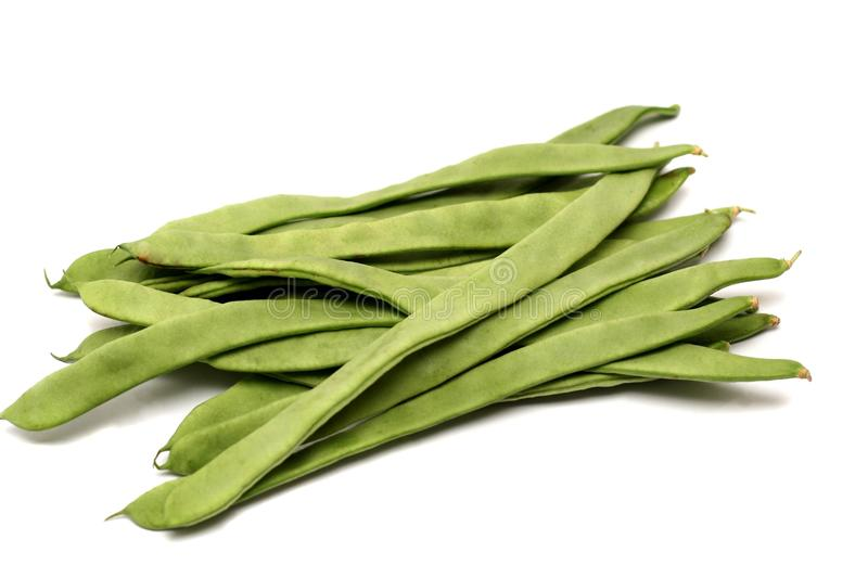 Runner beans, isolated. A handful of runner beans ready for preparation, isolated on a white background royalty free stock photo