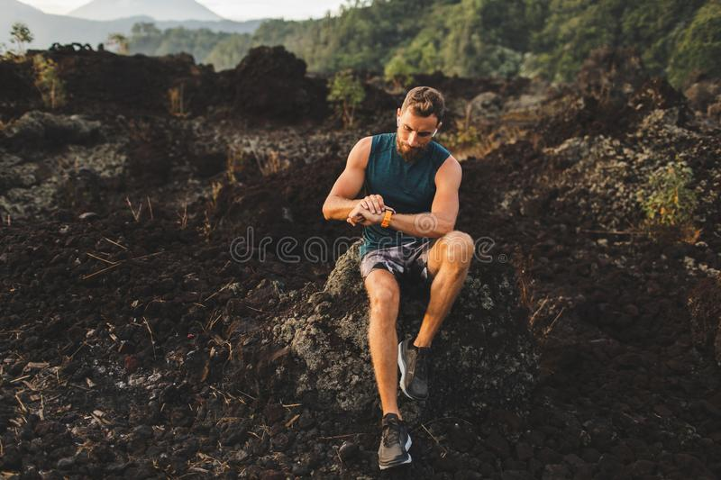 Runner checking training results on smart watch stock image
