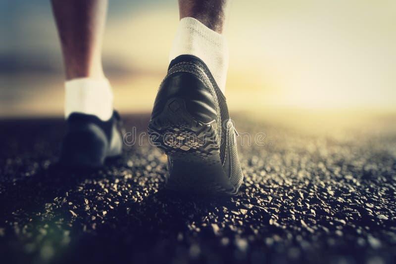 Runner feet at dawn. Close up royalty free stock image