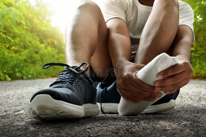 Runner feet injury on outdoor. S royalty free stock photography