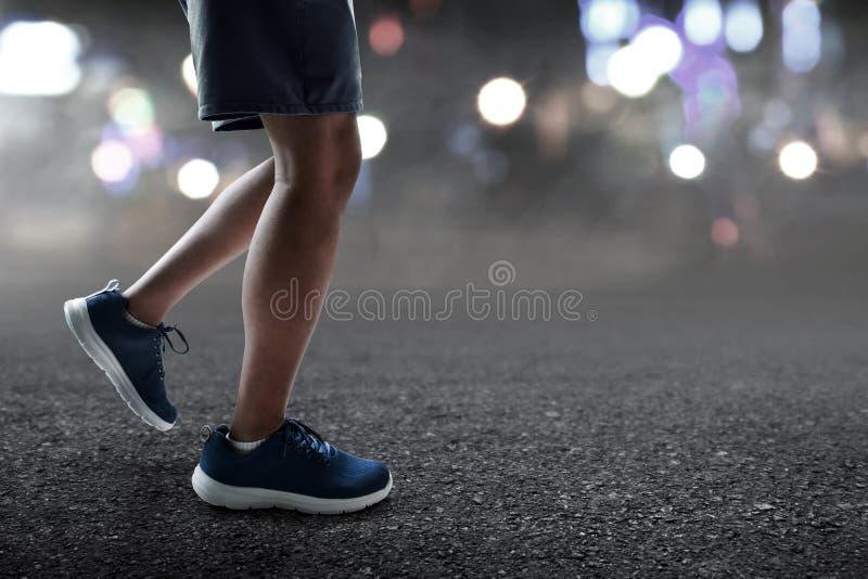 Runner feet running at night. Runner feet run at night royalty free stock photos