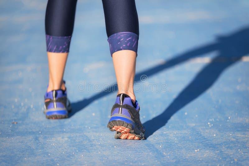 Runner feet running closeup on shoe. woman fitness jog workout welness concept. royalty free stock photo