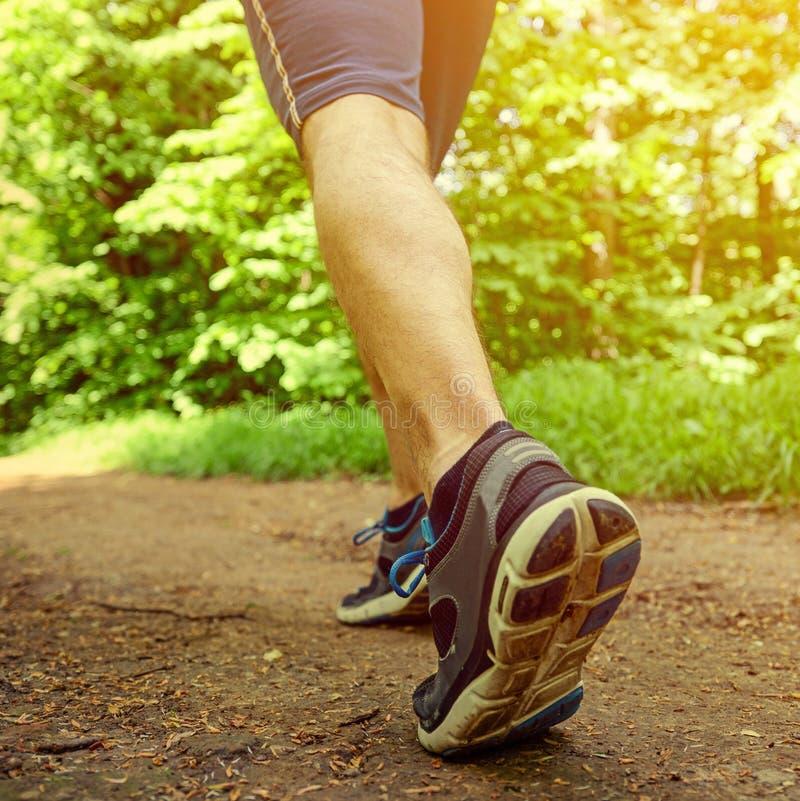 Runner feet running on road closeup on shoe royalty free stock image