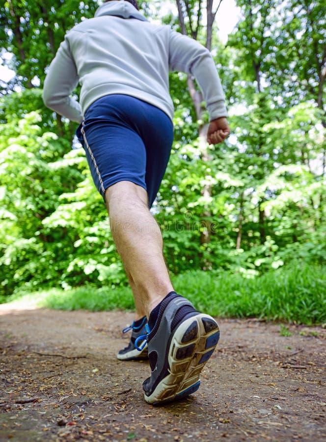 Runner feet running on road closeup on shoe royalty free stock photo