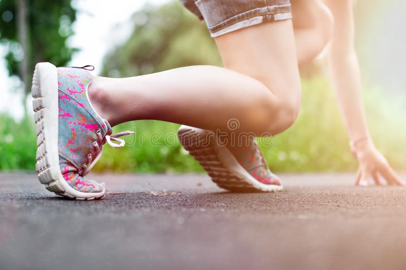 Runner feet running on road closeup on shoe royalty free stock photos