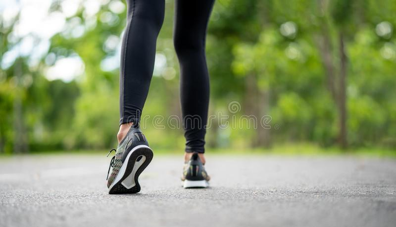 Runner feet running on road closeup on shoe. Young fitness woman runner athlete running at road. Athlete runner feet running on ro. Ad closeup on shoe. Woman stock image