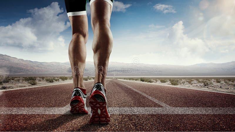 Runner feet running on road stock photo