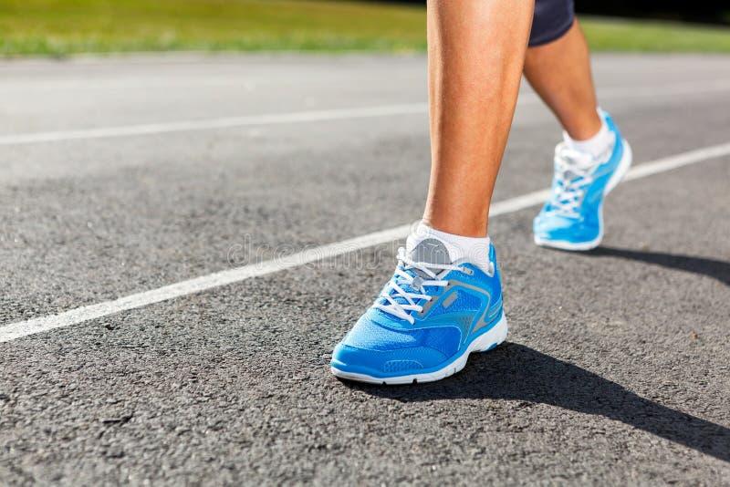 Runner Feet on Stadium Closeup. Runner Feet Running on Stadium Closeup - outdoor shot royalty free stock image