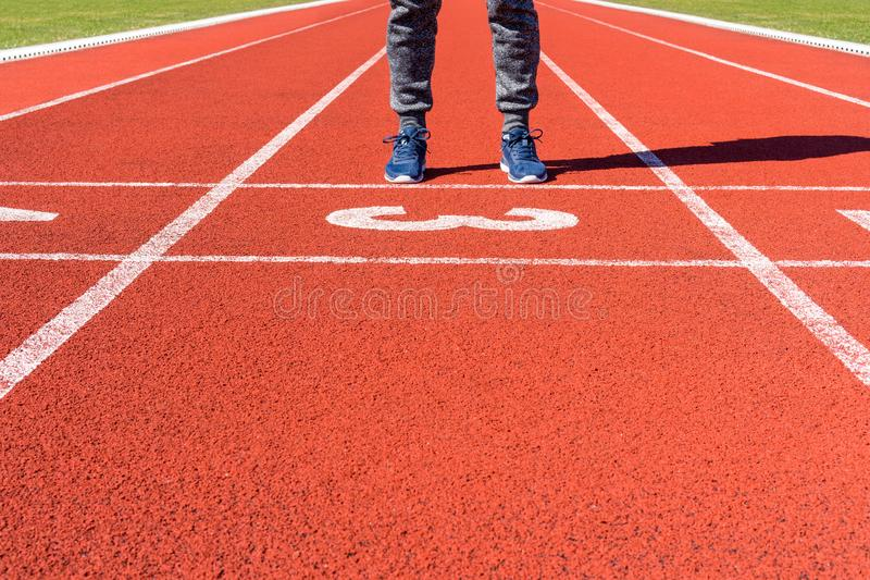 Runner feet on the starting line. Health and sport concept stock photo
