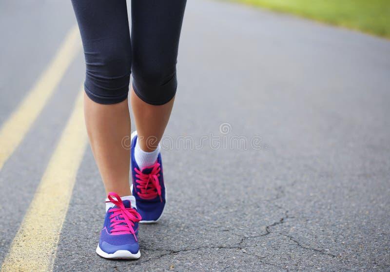 Runner Female Feet Running on Road. Jog royalty free stock photos