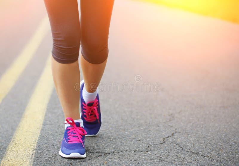 Runner Female Feet Running on Road. Jog stock images