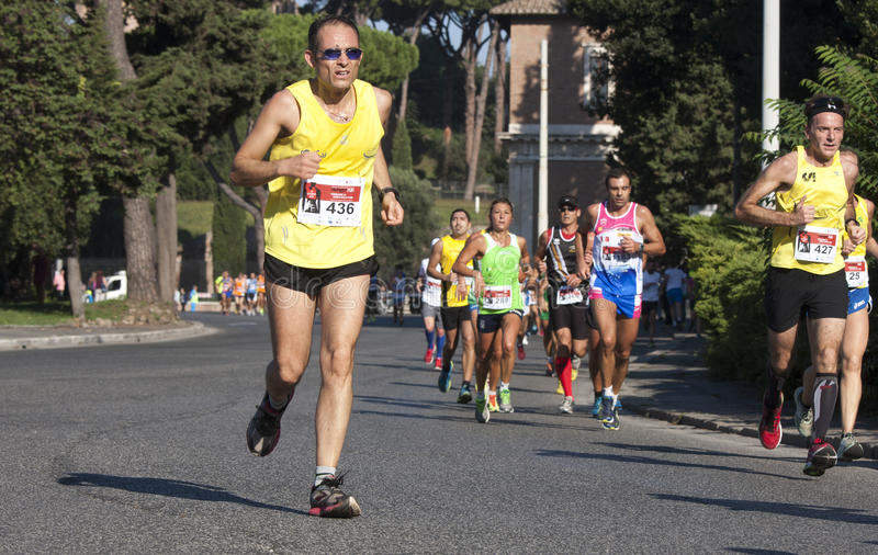 Runner foreground and several runners in background royalty free stock photography