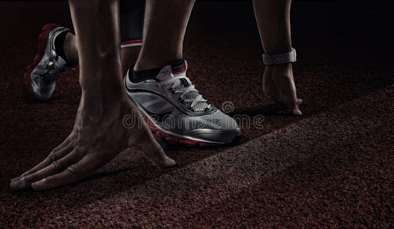 Runner. Hands on starting line. royalty free stock image