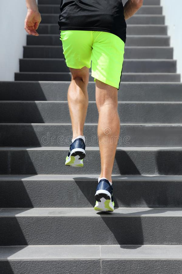 Runner man athlete running up the stairs on hiit high intensity interval training city run. Jogging jogger climbing staircase. Sprinting with speed. Urban stock images