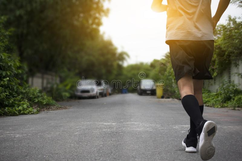 Runner Man run on the street be running for exercise,Run sports background and closeup at running shoe royalty free stock photos