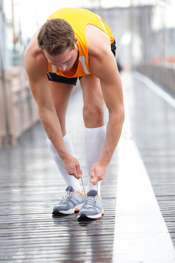 Download Runner Man Tying Laces On Running Shoes, New York Stock Photo - Image: 41567087