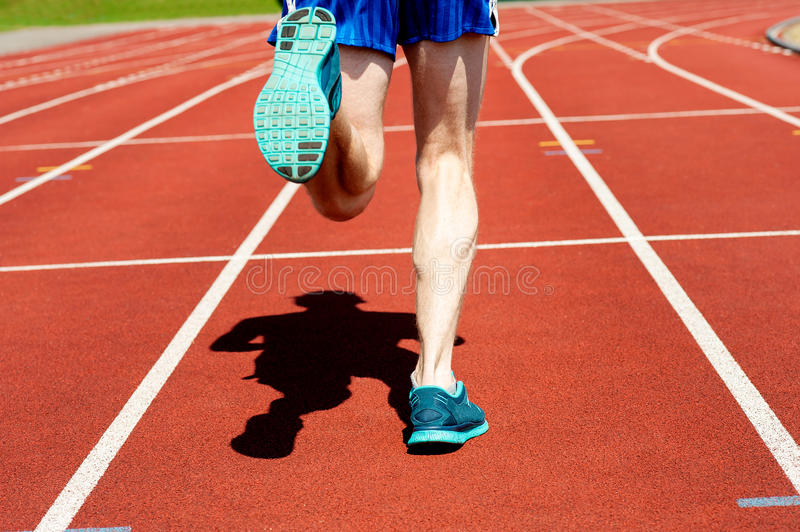 Runner practicing on a race track stock photos