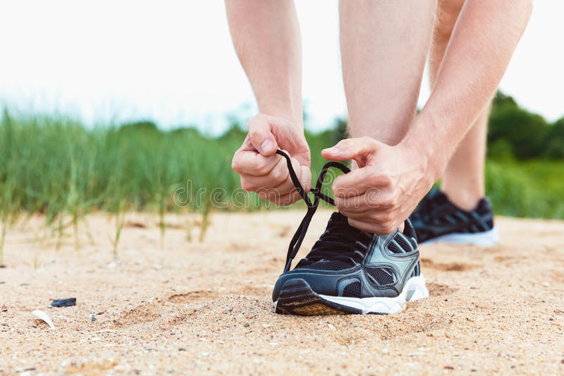 Runner preparing for a jog outdoors. Runner preparing to go for a jog outdoors stock image