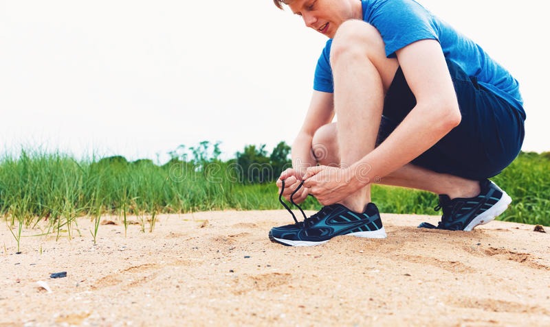 Runner preparing to go for a jog. Outdoors royalty free stock images