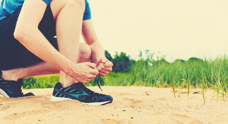 Runner preparing to go for jog outdoors. Runner preparing to go for a jog outdoors stock photography