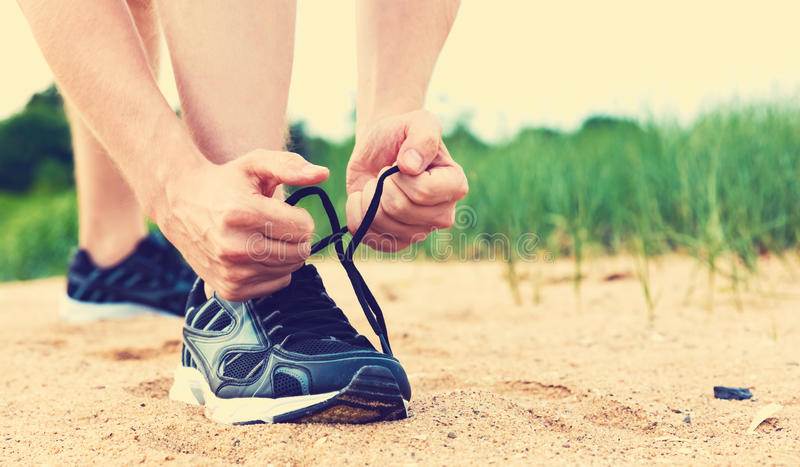 Runner preparing to go for jog outdoors. Runner preparing to go for a jog outdoors stock photos