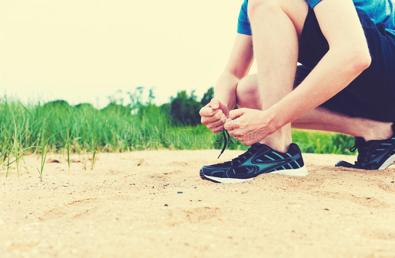 Runner preparing to go for a jog. Outdoors royalty free stock photos