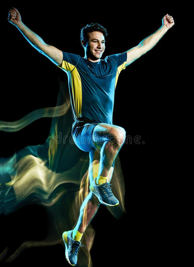 Runner running jogger jogging man isolated light painting black background royalty free stock photography