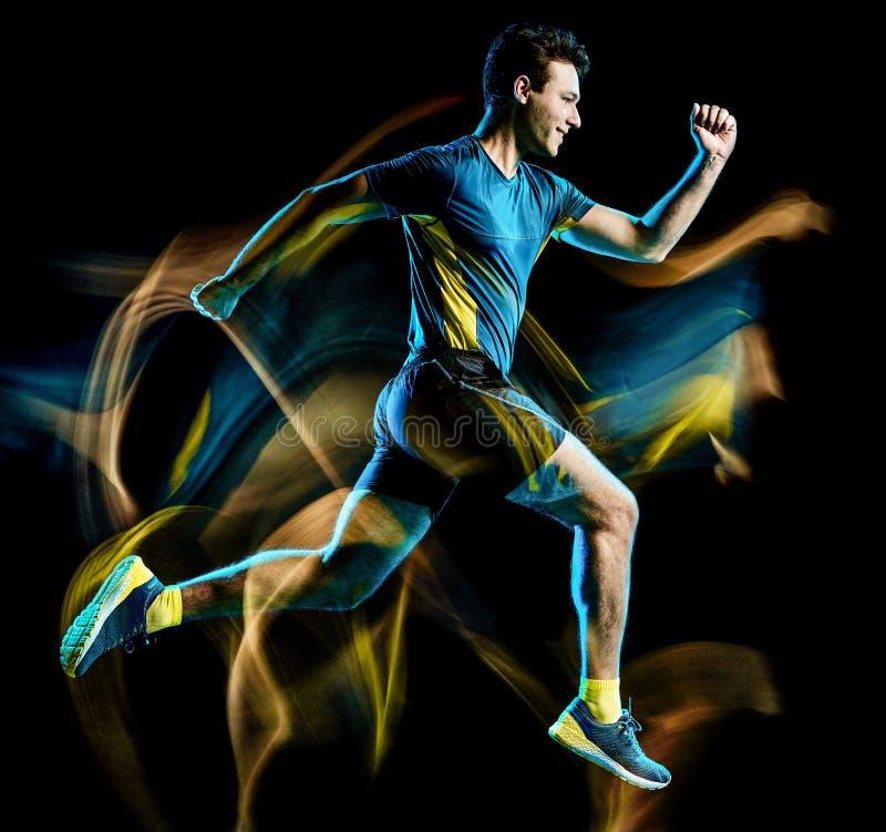 Runner running jogger jogging man isolated light painting black background stock photo