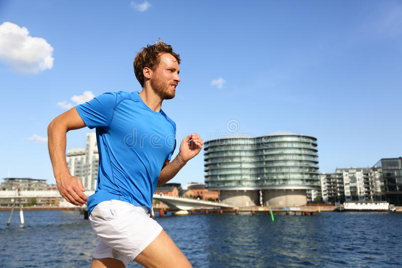 Runner running in urban Copenhagen city stock photos