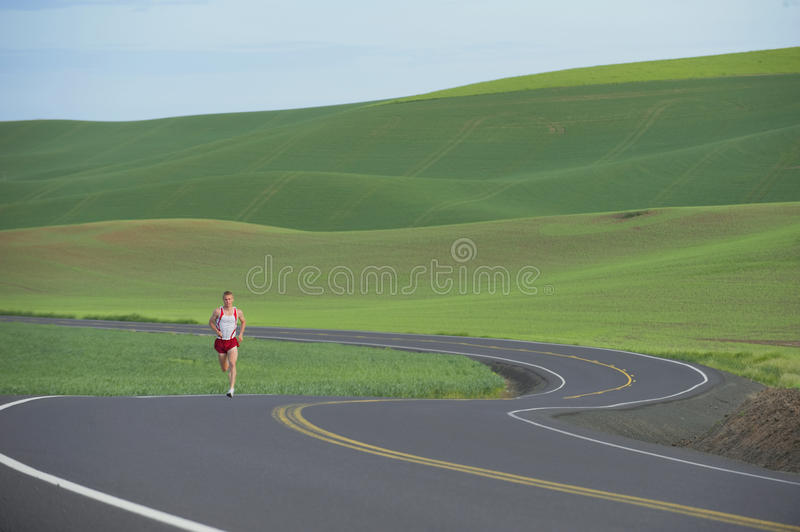 Download Runner on Rural Road stock image. Image of activity, lone - 9833163