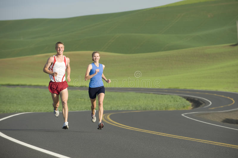 Download Runner on Rural Road stock photo. Image of road, adult - 9833220