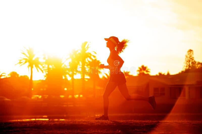 Runner silhoette sunset royalty free stock image