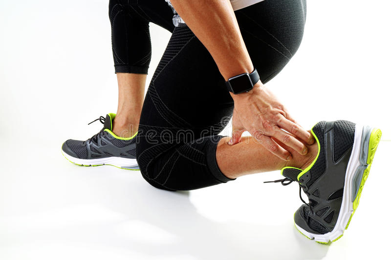 Runner sportsman holding ankle in pain with Broken twisted joint royalty free stock photography