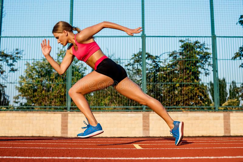 Runner sprinting towards success on run path running athletic track. Goal achievement concept. royalty free stock photography