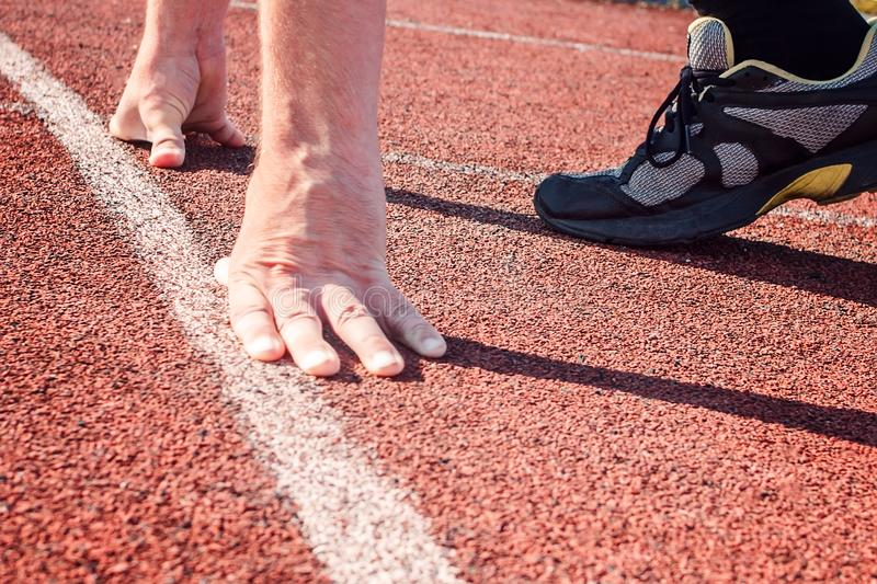 Runner in start position. Hands on starting line. royalty free stock photography