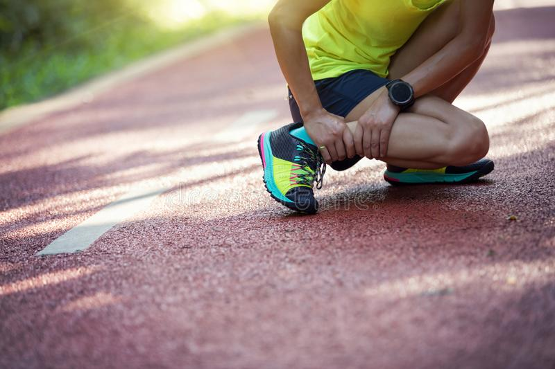 Runner suffering with pain on sports running injury. Female runner suffering with pain on sports running injury stock photo