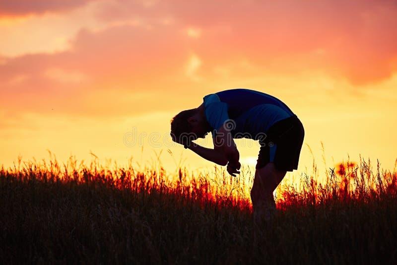 Runner at the sunset stock photo