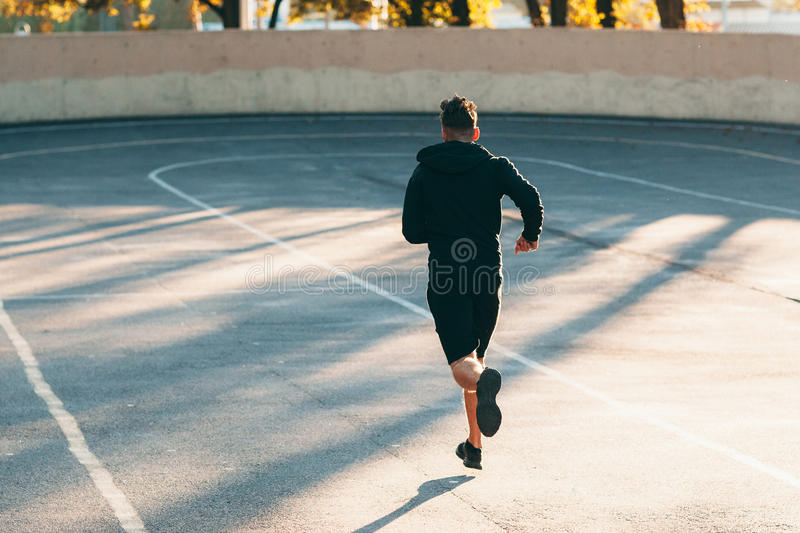 Runner on track at sport stadium, free space royalty free stock photos