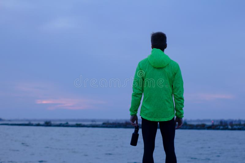 Runner training outdoors in autumn time royalty free stock photos
