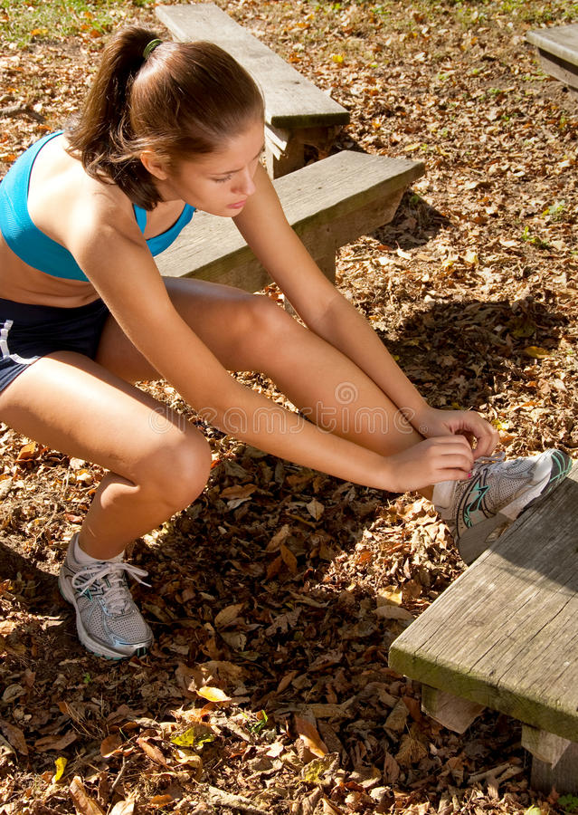Runner Tying Shoe Laces stock photos