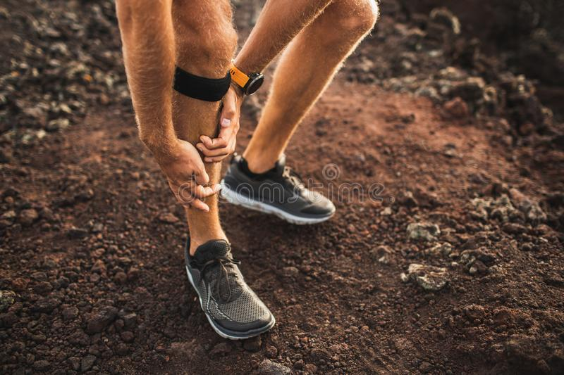 Runner using Knee support bandage with leg injury royalty free stock photography