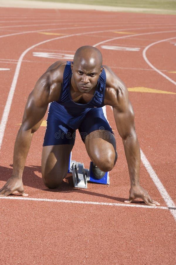 Download Runner Waiting At Starting Block Stock Image - Image: 30843849