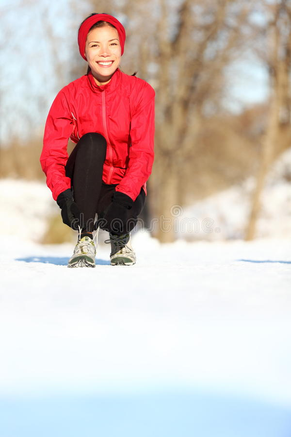 Runner in winter snow royalty free stock photo